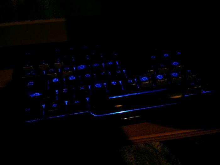 High angle view of computer keyboard at night