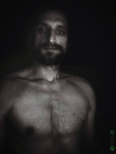 Shirtless Portrait Dark Looking At Camera Indoors  Men Black Background Mobile Phone Camera
