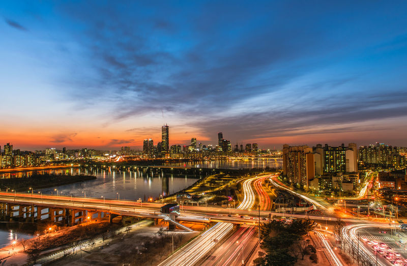 Evening sunset at the Han River in winter South Korea Architecture Bridge - Man Made Structure Building Building Exterior Built Structure City City Life Cityscape Cloud - Sky Illuminated Light Trail Long Exposure Modern Motion Night No People Office Building Exterior Outdoors Road Sky Skyscraper Speed Street Tall - High Transportation