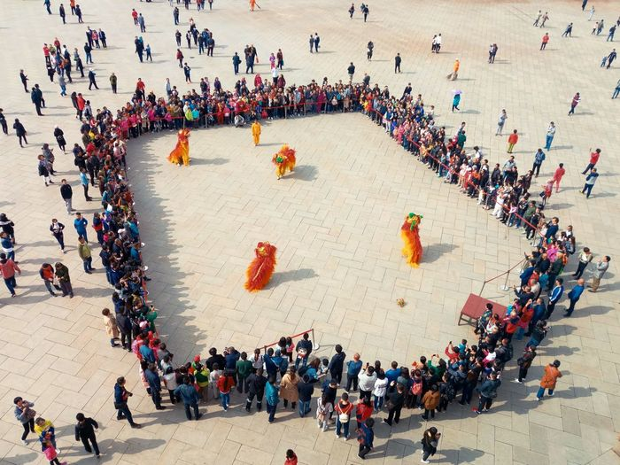 High Angle View Of People Watching Street Performer