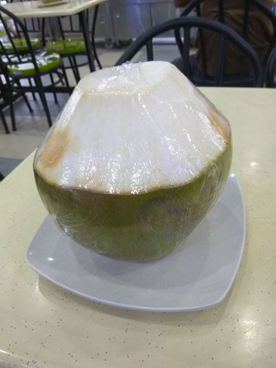 Coconut on the table Food And Drink Indoors  Drink No People SLICE Cocktail Luxury Cold Temperature Day Food Tonic Water Freshness Close-up Asian Culture Delicous Plastic Wrap Healthy