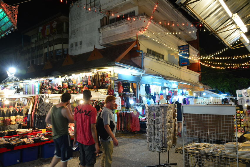 Bazaar Built Structure Casual Clothing Chiang Rai, Thailand City City Life Crowd Cultures Display Illuminated Large Group Of People Leisure Activity Lifestyles Lighting Equipment Market Market Stall Mixed Age Range Night Night Bazaar Outdoors Retail  Store