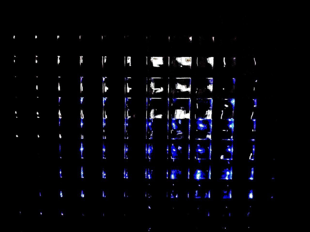 VIEW OF ILLUMINATED LIGHTS AT NIGHT