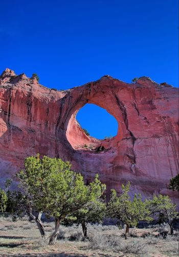 Window Rock, Arizona. Arch Archway Arizona Beauty In Nature Blue Clear Sky Cliff Day Eroded Famous Place Geology Mountain Natural Landmark Nature Navajo No People Non-urban Scene Outdoors Physical Geography Rock Formation Sandstone Wall Scenics Tranquil Scene Tranquility Window Rock