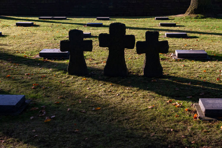 Shadow of cross on cemetery