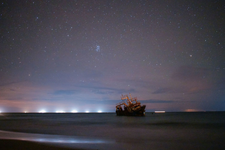 Night Astronomy Star - Space Beauty In Nature Outdoors Water Sea Taking Pictures Beachphotography Seascape Photography Ships At Sea Ships⚓️⛵️🚢 Sunkship Clearwaterbeach Sunkenboat Clear Sky No People Nightsea Dark Skynightphotography