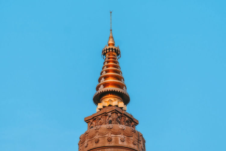 Low angle view of bell tower against blue sky