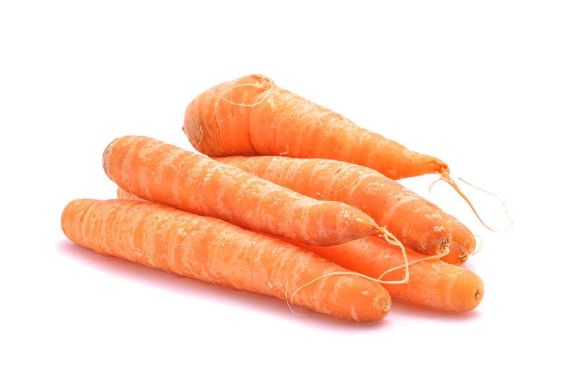 Close-up of orange pepper against white background