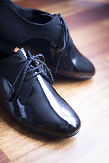 High angle view of formal shoes on wooden table