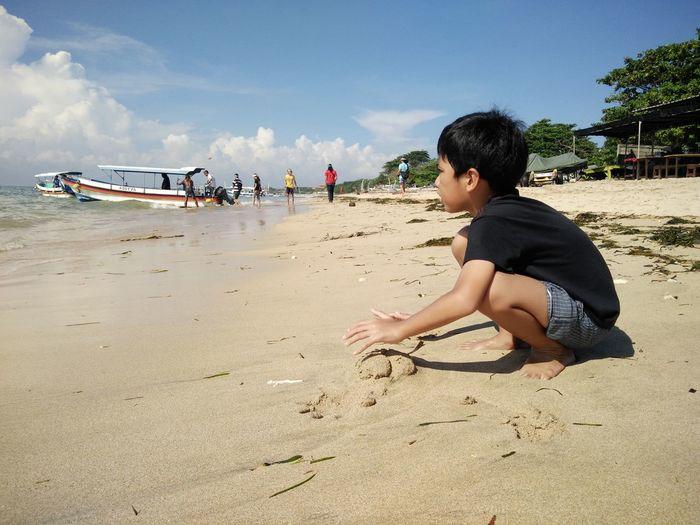 Beach Casual Clothing Day Enjoyment Full Length Fun Leisure Activity Lifestyles Nature Outdoors Sand Shore Sky Summer Vacations Tanjungbenoa Bali, Indonesia Nusadua