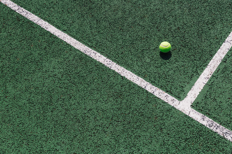 Tennis Ball Court Day Grass Green Color High Angle View No People Outdoors Sport Tennis Tennis Ball White Color
