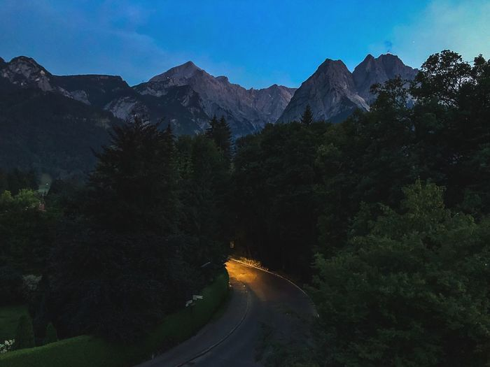 Headlights on a street in the mountains Alpspitze Alps Alpen Headlights Headlight Mountain Scenics - Nature Mountain Range Tree Night Beauty In Nature Plant Nature Sky No People Landscape Environment Tranquil Scene Star - Space Mountain Peak Tranquility Non-urban Scene Travel