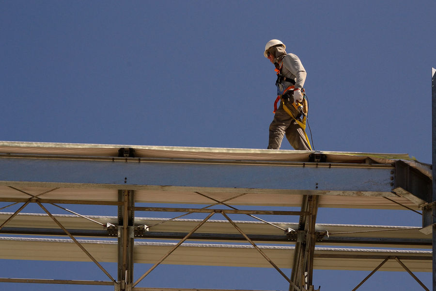 Architecture Blue Clear Sky Construction Site Construction Worker Day Full Length Hardhat  Headwear Helmet Industry Low Angle View Manual Worker Men Occupation One Man Only One Person Outdoors Real People Sky Standing Steel Worker Welder Working