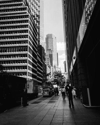 People walking on modern office buildings