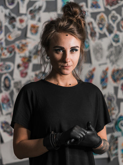 Piercing master, portrait Looking At Camera One Person Front View Indoors  Portrait Waist Up Young Adult Wall - Building Feature Casual Clothing Real People Standing Young Women Women Lifestyles Creativity Focus On Foreground Graffiti Leisure Activity Beautiful Woman Hairstyle