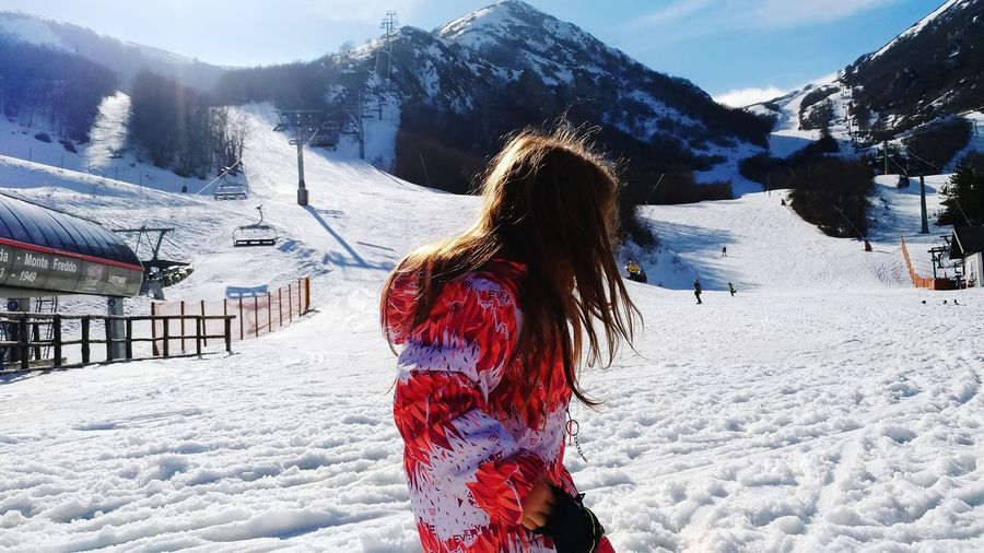 Woman on snow covered mountains during winter