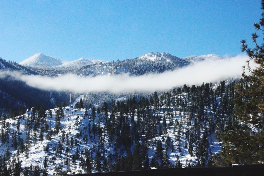 Nevada Snow Mountains On The Road Over Clouds Peaking Through Nature