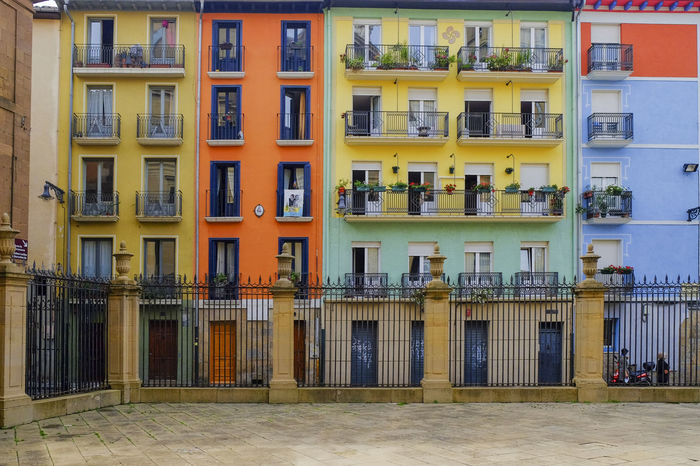 In front of the Catedral de Santa Maria la Real, Pamplona, Spain Architecture Balcony Building Building Exterior Built Structure City Day Exterior Façade In A Row Modern No People Outdoors Reflection Repetition Residential Building Residential Structure Side By Side Window The Architect - 2016 EyeEm Awards
