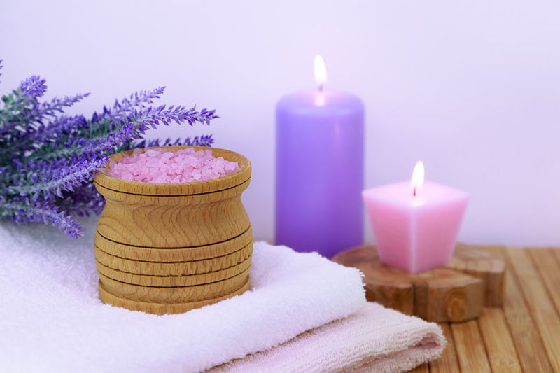 sea salt on a wooden table in the bathroom, concept - body care No People Nobody Relax Cozy Skin Care Bath Candle Natural Pink Salt Wellness Bathroom Beauty Care Crystal Freshness Health Healthy Indoors  Ingredient Mineral Organic Pampering Purple Sea Spa Towel Towels Treatment White Wooden