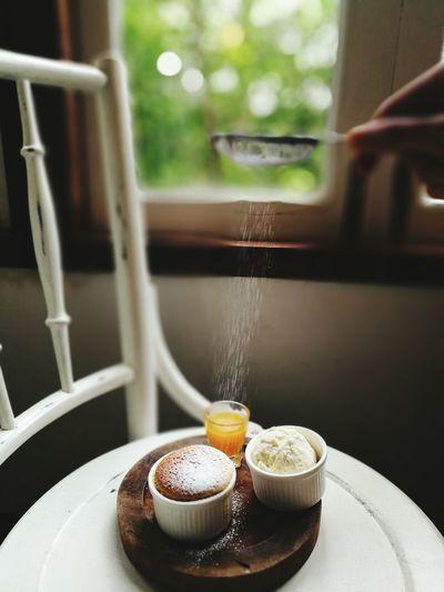 Cropped Hand Putting Powdered Sugar From Strainer On Dessert