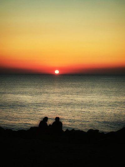 beautiful moment.... Couples❤❤❤ Couple Sunset Beauty In Nature Sea Sun Scenics Nature Dramatic Sky Beach