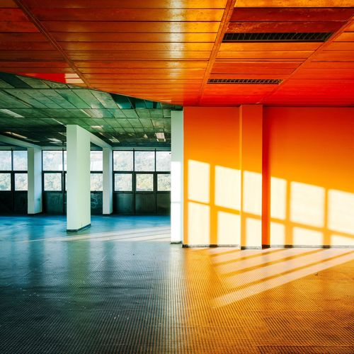 Inside Rozzol Melara Interior Modern Architecture Minimalism Trieste Italy Office Business Ceiling Empty Corridor Orange Color Sunset Hallway