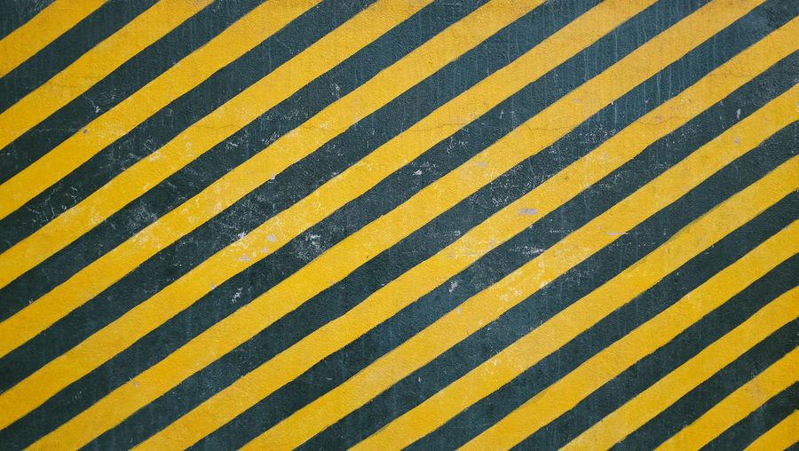Full Frame Shot Of Black And Yellow Crosswalk