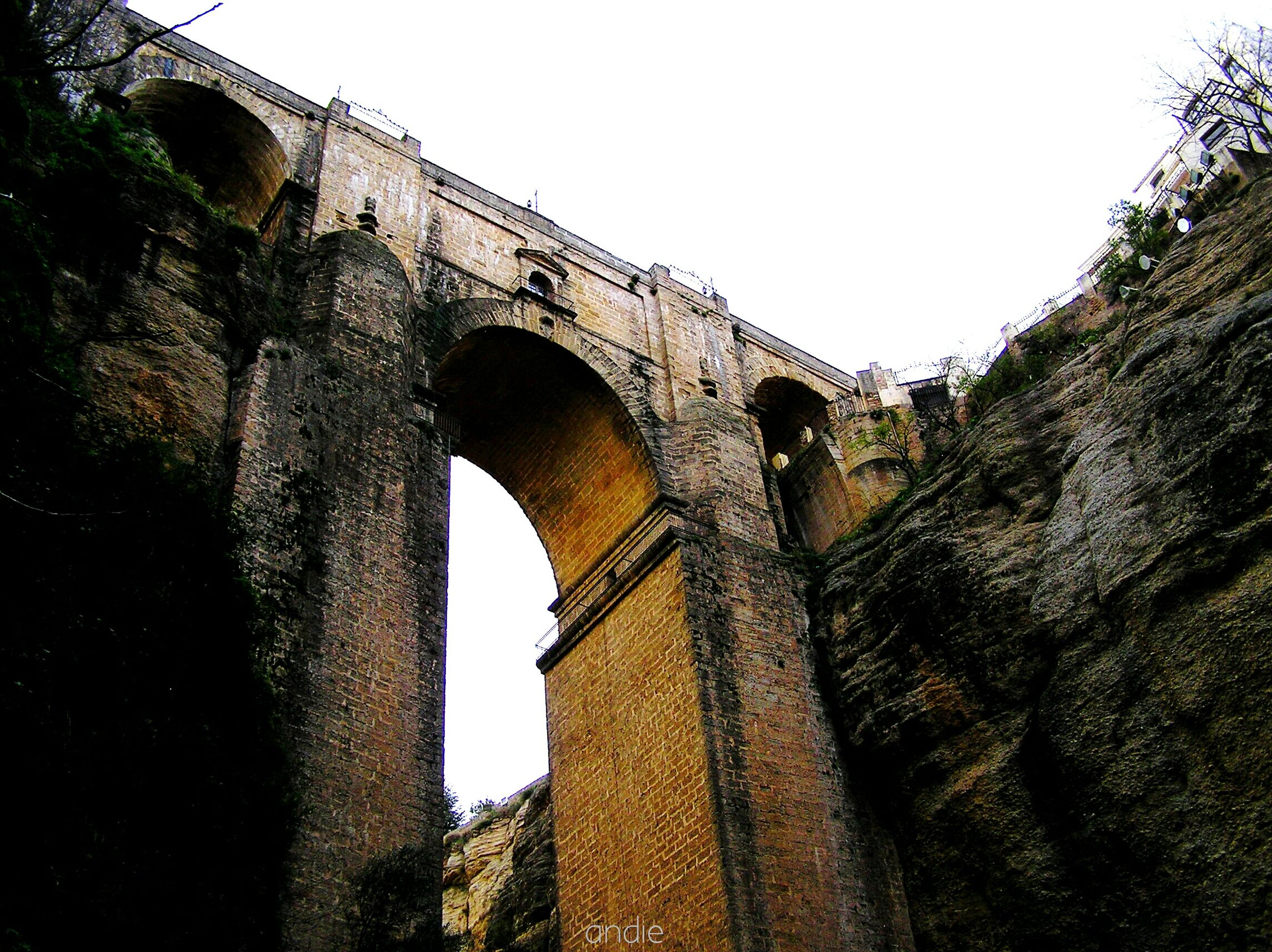 architecture, built structure, arch, clear sky, low angle view, history, connection, bridge - man made structure, old, building exterior, tree, old ruin, stone wall, arch bridge, sky, day, outdoors, no people, the past, ancient
