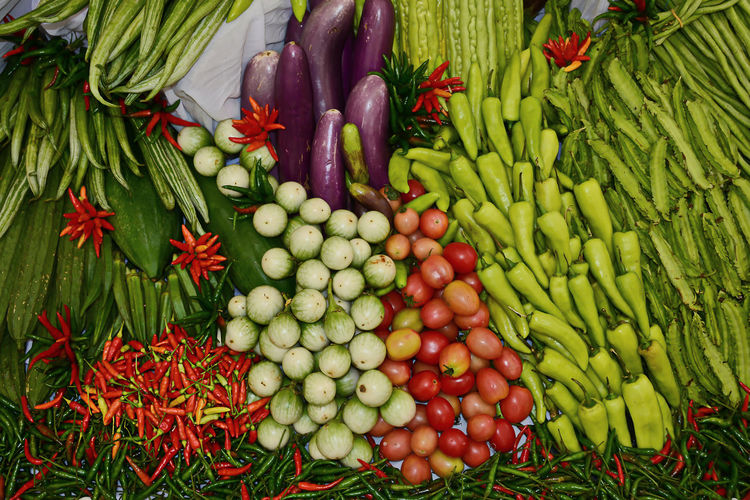Composition with assorted raw organic vegetables Abundance Choice Day Food Food And Drink Freshness Green Color Healthy Eating High Angle View Large Group Of Objects Market No People Outdoors Raw Food Retail  Variation Vegetable