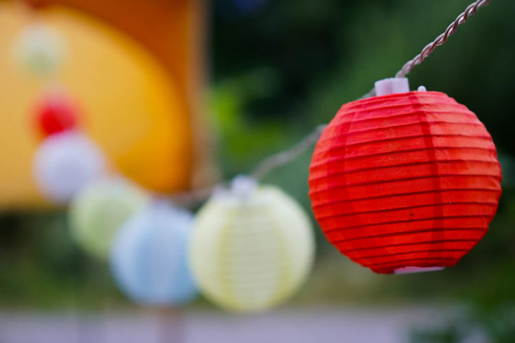 Celebration Chinese Lantern Chinese New Year Close-up Day Decoration Festival Focus On Foreground Hanging Holiday Lantern Lighting Equipment Nature No People Outdoors Plant Red Selective Focus Toy The Still Life Photographer - 2018 EyeEm Awards EyeEmNewHere