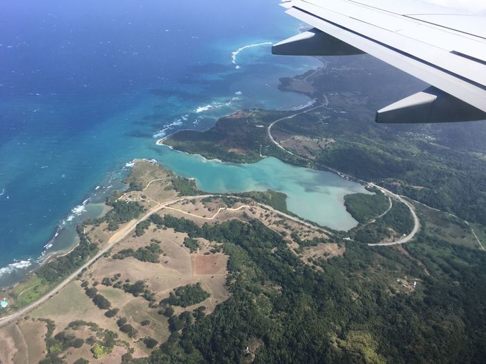 Aerial View Air Vehicle Aircraft Wing Airplane Airplane Wing Beauty In Nature Blue Day Flying Jamaica Journey Landscape Lucea Mid-air Nature No People Outdoors Scenics Sea Sky Transportation Water