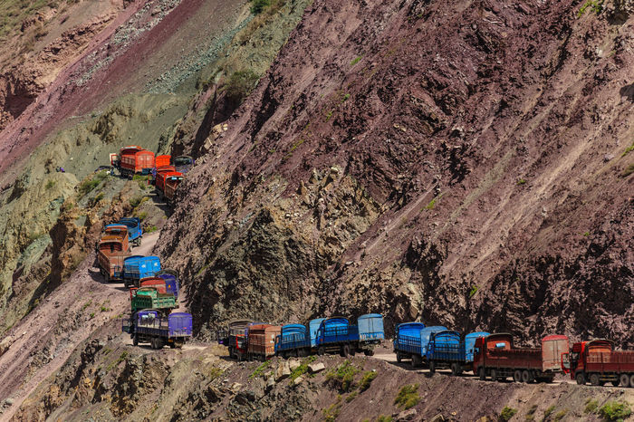 A seemingly endless line of trucks on an impossibly narrow mountain road in China. Now, that's a traffic jam I wouldn't want to be caught in! Long Line Lorry Precarious Queue Queueing Road Traffic Jam China Land Vehicle Lorries Mode Of Transport Mountain Mountain Road No People Precariously Transportation Truck Trucks