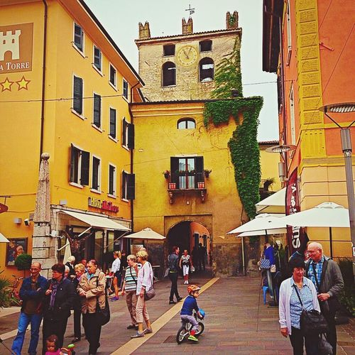 In the streets of Italy Untold Stories Life Culture Pastel Power Architecture Building Exterior Buildings City Brick Wall Colors People Watching People Lake Garda Watching Streetphotography