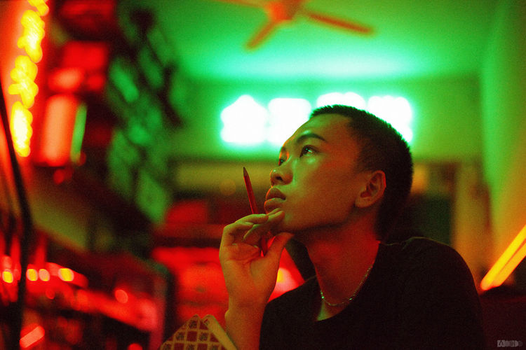 Portrait of young woman smoking at restaurant