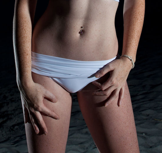 Midsection of woman wearing panty