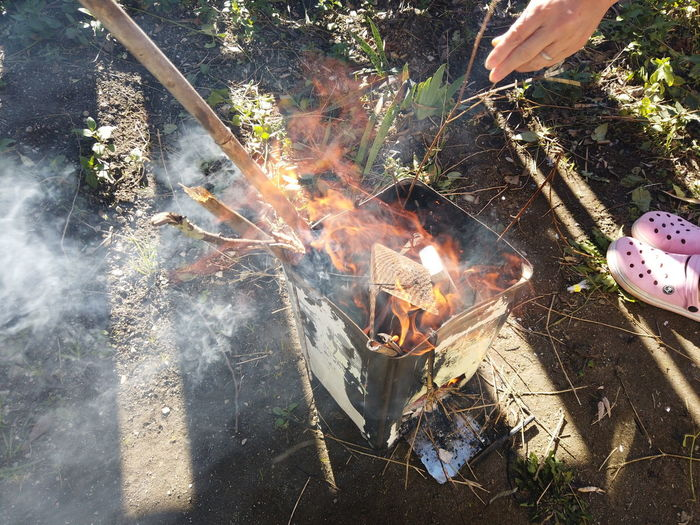 Make A Fire Camping Garden Outdoors Flame Burning Twig Branches Fire Heat - Temperature Fire - Natural Phenomenon Nature Day High Angle View Barbecue Food Real People Smoke - Physical Structure Food And Drink Bonfire Human Hand Preparation  Meat Hand Preparing Food Campfire