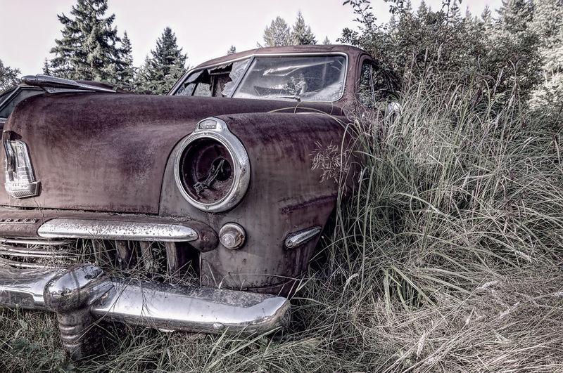 Old vintage car on field