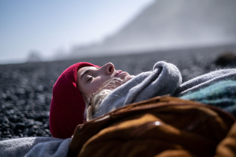Iceland; Roadtrip; Vik Lying Down One Person Relaxation Eyes Closed  Headshot Blanket Clothing Winter Lifestyles Day Resting Adult Leisure Activity Real People Portrait Lying On Back Selective Focus Warm Clothing Autumn Mood The Week On EyeEm Editor's Picks