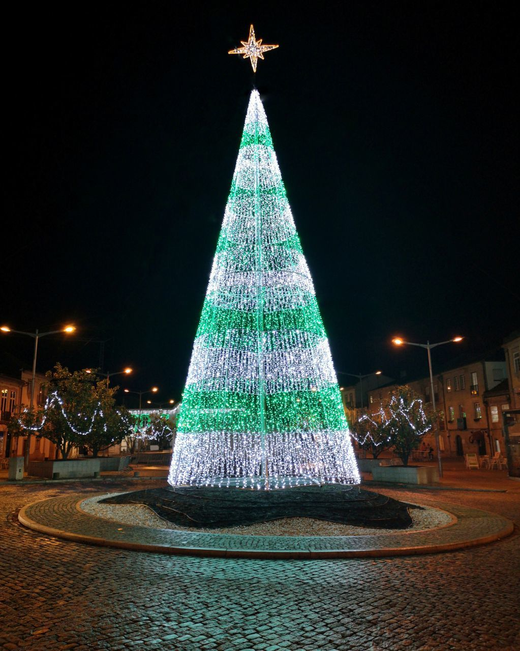 ILLUMINATED CHRISTMAS TREE AT NIGHT DURING FESTIVAL