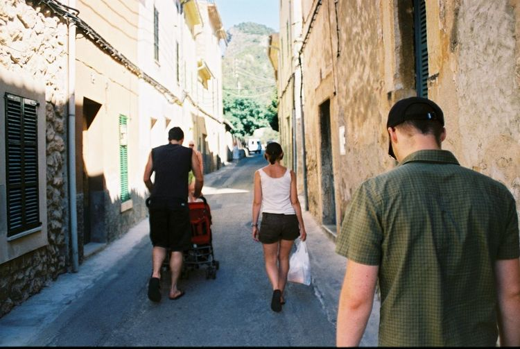 People in narrow alley
