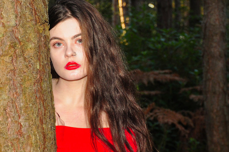 Beautiful young lady in a red jumper in a forest in the autumn Girl Millenial Young Lady Red Red Color Red Lipstick Forest Trees Beauty Beautiful Woman Beautiful Long Hair Portrait Portrait Of A Woman Portrait Photography Tree Trunk Red Jumper Off The Shoulder Stunner Beautiful Young Lady Beautiful Young Woman Autumn Autumn colors autumn mood Tree One Person Young Adult Young Women Looking At Camera Lipstick Real People Headshot Trunk Make-up Outdoors