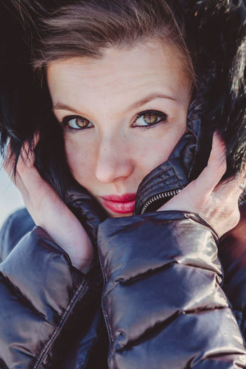 Close-up portrait of woman standing outdoors during winter