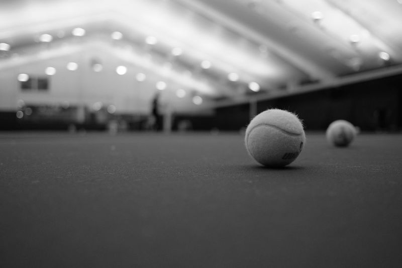 Resting Tennis Balls Tennis Ball Illuminated Indoors  Leisure Activity No People Selective Focus Sport Sports Equipment Surface Level