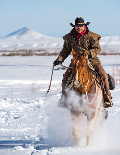 Feb 2019 - Music Meadows Ranch Winter One Person Cold Temperature Mammal Domestic Snow Real People Animal Animal Themes Domestic Animals Day Horse One Animal Mountain Riding Warm Clothing Outdoors Cowboy Cowboy Hat Chaps Full Steam Ahead Breath Powder Snow Colorado