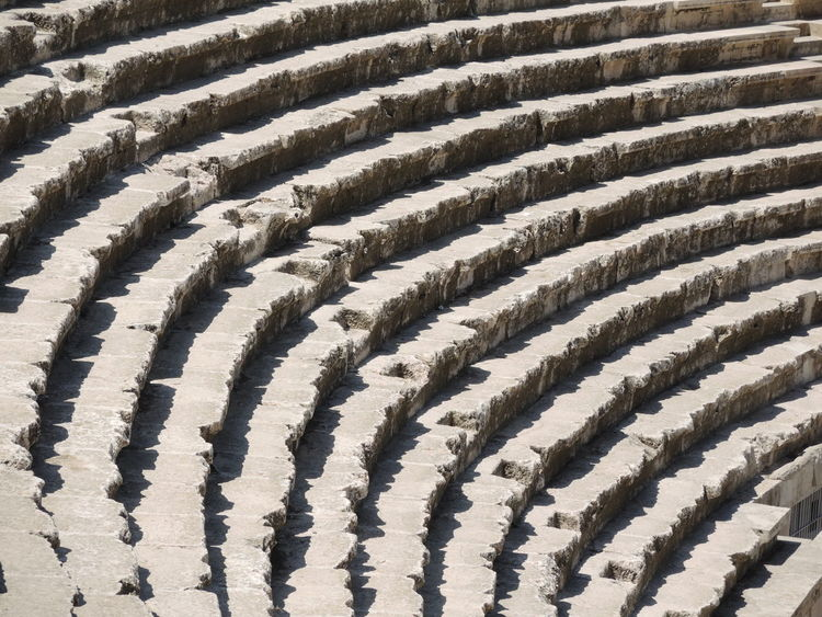 The theatre was built during the reign of Antonius Pius (138-161 CE). The large and steeply raked structure could seat about 6,000 people. Amman Amphitheater Backgrounds Close-up Concentric Day Geometric Shape Jordan No People Outdoors Pattern Roman Amphitheater Roman Ruins Roman Theater Roman Theatre Minimalist Architecture Minimalist Architecture