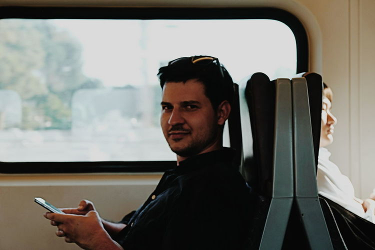 Dario Commuting on a Caltrain for Google I/O // Silicon Valley Smart Phone Wireless Technology Mobile Phone Portable Information Device Transportation Communication Mode Of Transport Real People Technology Lifestyles Land Vehicle Leisure Activity Connection Holding Indoors  Smiling Window Men Day Using Phone One Person Young Adult Close-up FUJIFILM X-T10 XF18-55mmF2.8-4 R LM OIS F/4.0 Iso 200 1/60 Sec Photographing Photography Themes Cellphone Selfie Photo Messaging Touch Screen Young Men Sitting Text Messaging Telecommunications Equipment via Fotofall