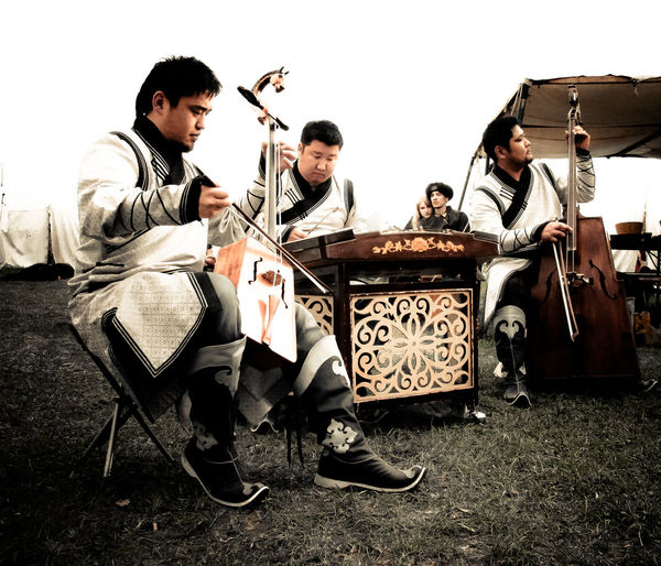 "The Mongolian band ""Sedaa"" surprised me with their deep voices and their traditional singing and playing on the medieval market in Freienfels (Germany). Acustic  Asian  Asian Culture Band Composition Culture Cultures Grass Instrument Instruments Lifestyles Medieval Medieval Market Men Mittelalter Mongolia Mongolian Music Robe Sitting Togetherness Traditional Traditional Clothing What Does Music Look Like To You? White Robes"