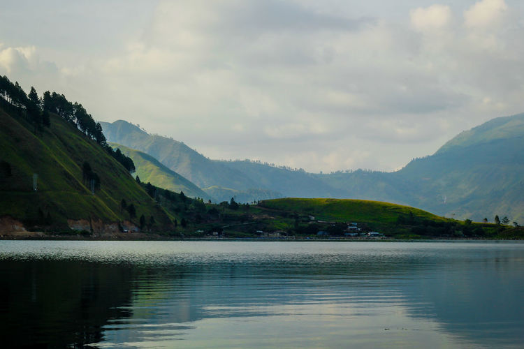 The View of Tongging, Lake Toba. North Sumatera, Indonesia Beauty In Nature Day Lake Landscape Mountain Mountain Range Nature No People Outdoors Range Reflection Scenics Sky Tranquil Scene Tranquility Tree Water Waterfront