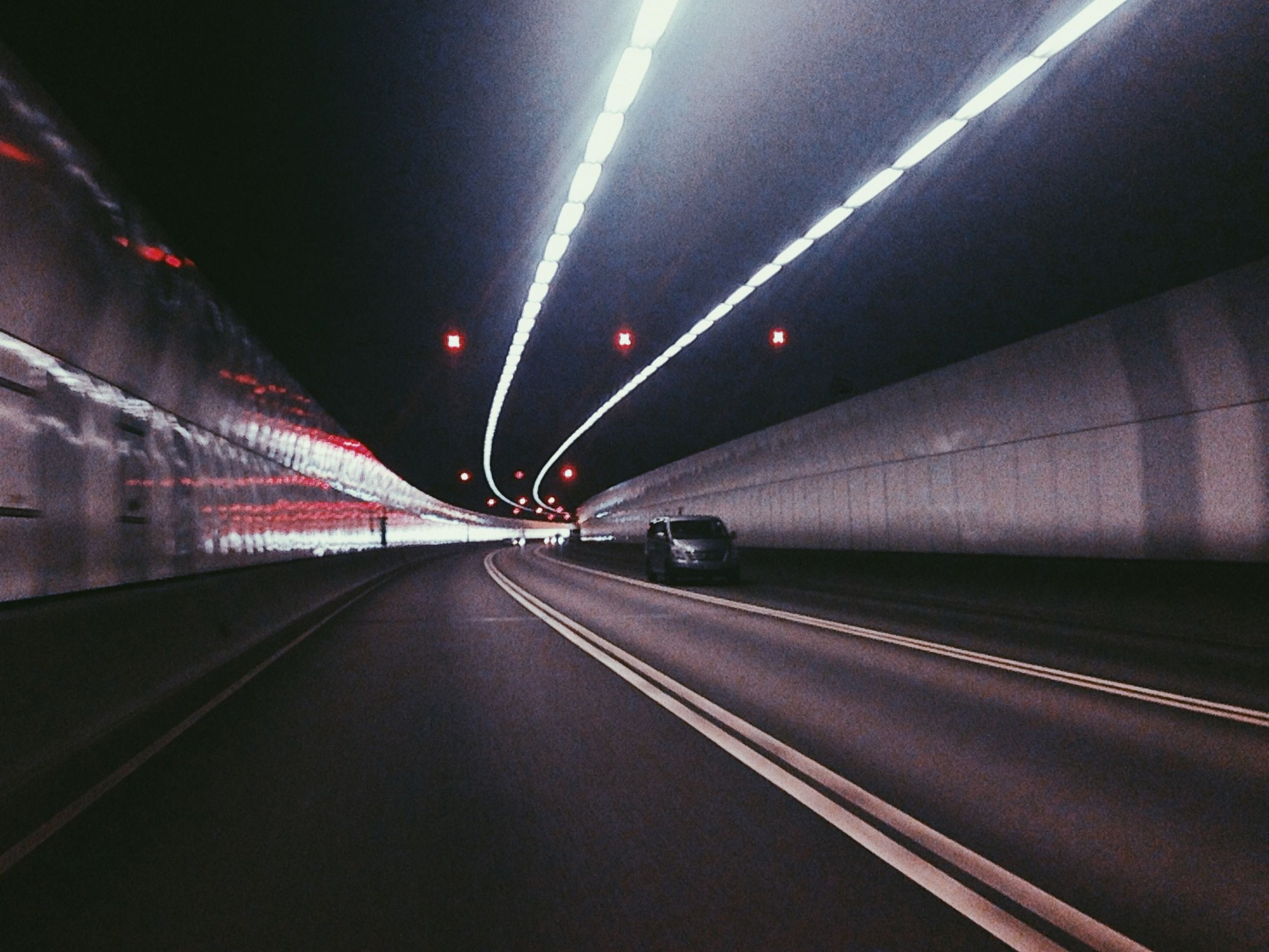 transportation, illuminated, the way forward, road, road marking, diminishing perspective, tunnel, night, vanishing point, mode of transport, motion, long exposure, speed, on the move, light trail, blurred motion, lighting equipment, indoors, travel, land vehicle