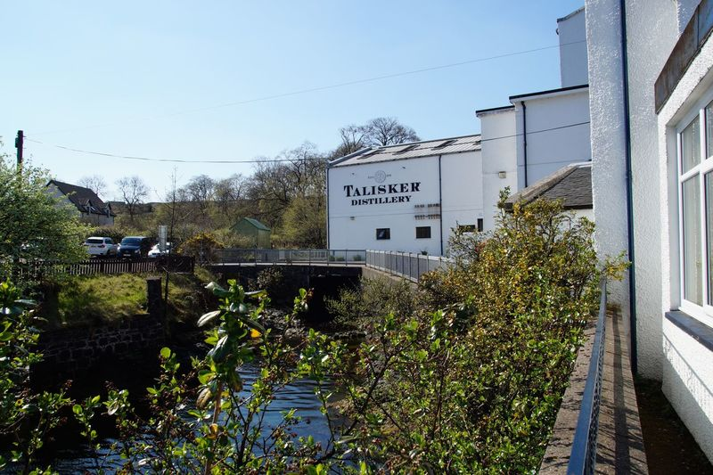 Distillery Destillery Whisky Talisker Text Architecture Building Exterior Built Structure Day Outdoors Plant Tree Nature Sky No People Growth Clear Sky